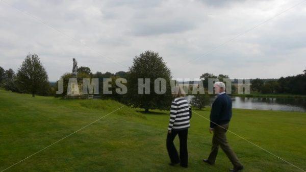 ENGLAND – CIRCA 2011: Couple walking through english park. - Actor Stock Footage