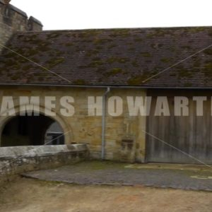 ENGLAND – CIRCA 2011: Fast pan past barns and rear entrance at Penshurst Place. - Actor Stock Footage