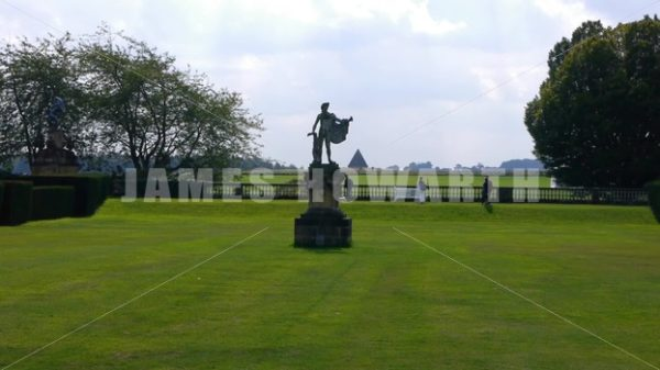 ENGLAND – CIRCA 2011: Man statue and pyramid at Howard Castle. - Actor Stock Footage
