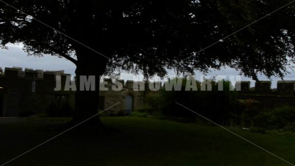 ENGLAND – CIRCA 2011: Pan across grounds to small tower at Penshurst Place Castle. - Actor Stock Footage