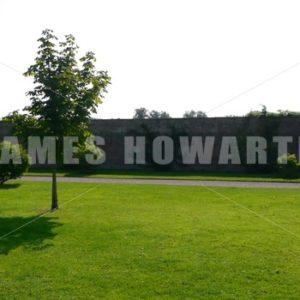 ENGLAND – CIRCA 2011: Pan by Howard Castle garden wall. - Actor Stock Footage
