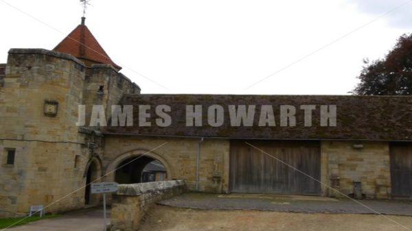ENGLAND – CIRCA 2011: Pan past barns and rear entrance at Penshurst Place. - Actor Stock Footage