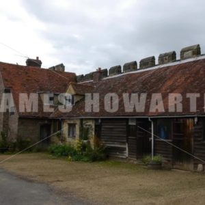 ENGLAND – CIRCA 2011: Pan past barns at Penshurst Place. - Actor Stock Footage