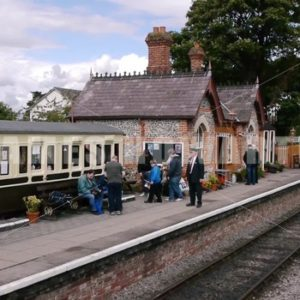 ENGLAND – CIRCA 2011: Pan to old english country train station. - Actor Stock Footage