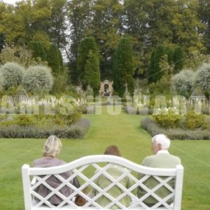 ENGLAND – CIRCA 2011: People sitting on garden bench. - Actor Stock Footage