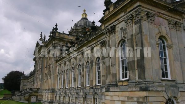 ENGLAND – CIRCA 2011: Side view Howard Castle with birds swarming around. - Actor Stock Footage