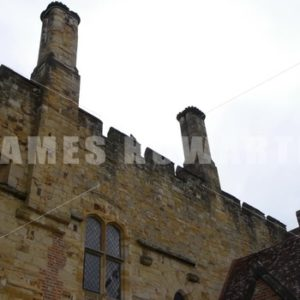 ENGLAND – CIRCA 2011: Tilt down from chimneys to doors of Penshurst Place Castle. - Actor Stock Footage