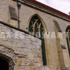 ENGLAND – CIRCA 2011: Tilt down from old english church to grave stones. - Actor Stock Footage