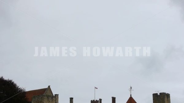 ENGLAND – CIRCA 2011: Tilt down to Penshurst Place Castle spires roof tops. - Actor Stock Footage