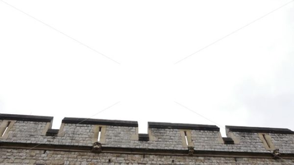 ENGLAND – CIRCA 2011: Tilt down to windows of Windsor Castle. - Actor Stock Footage
