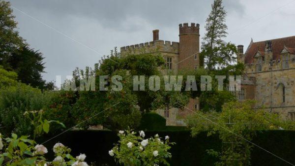 ENGLAND – CIRCA 2011: Tilt up past flower garden to Penshurst Place Castle. - Actor Stock Footage