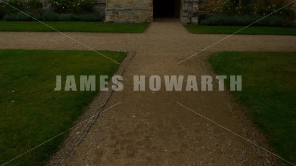 ENGLAND – CIRCA 2011: Tilt up to dark doorway at Penshurst Place Castle. - Actor Stock Footage