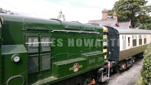 ENGLAND – CIRCA 2011: Train going through old english country train station. - Actor Stock Footage