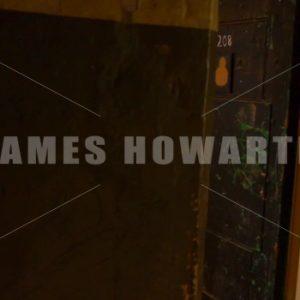ENGLAND – CIRCA 2011: Walking past dungeon jail cell. - Actor Stock Footage