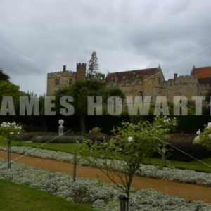 ENGLAND – CIRCA 2011: Walking past flower garden at Penshurst Place Castle. - Actor Stock Footage