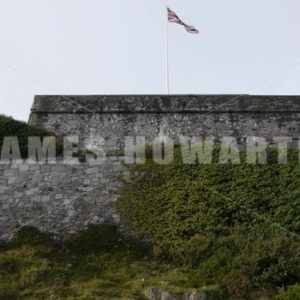 ENGLAND – CIRCA 2011: English flag flying a top of a military wall - Actor Stock Footage