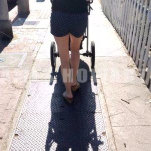 A woman's legs pushing pram stroller. - Actor Stock Footage