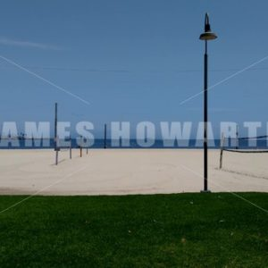 Pan across volleyball nets and beach. - Actor Stock Footage