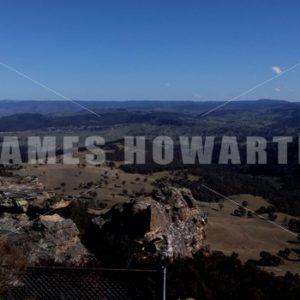 Pan around at mountain top. - Actor Stock Footage