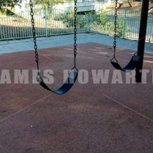 Solitary swings in a playground swaying. - Actor Stock Footage