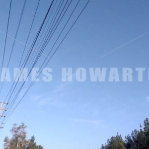 Tilt down from sky to empty Los Angeles concrete water river channel. - Actor Stock Footage