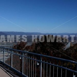 Walk down mountain catwalk. - Actor Stock Footage
