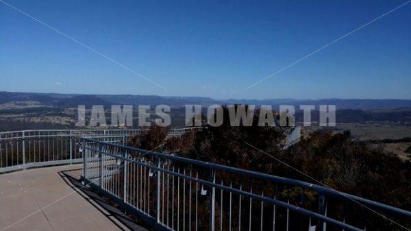 Walk down mountain catwalk. - Actor Stock Footage