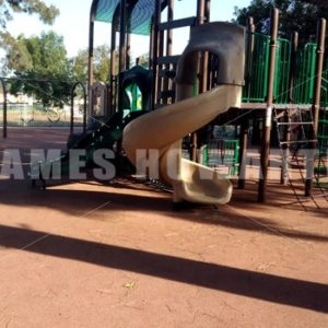 Walking into a playground gated area. - Actor Stock Footage