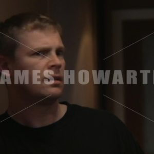 A man hears something in a hallway. - Actor Stock Footage