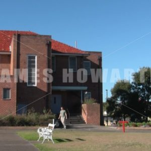 A man leaving the hospital with his bag. - Actor Stock Footage