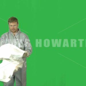 A man puts on his hazmat helmet on. - Actor Stock Footage
