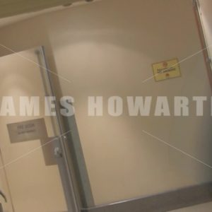 A man running down a hallway and doorway at a left angle. - Actor Stock Footage