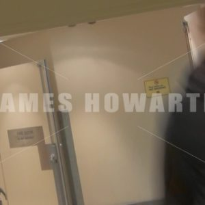 A man running down a hallway at a left angle. - Actor Stock Footage