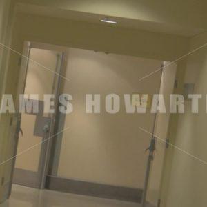 A man runs down a hallway dutch angle2. - Actor Stock Footage