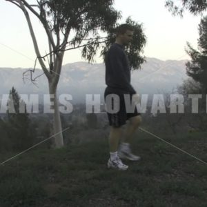 A man walks past mountains side view. - Actor Stock Footage