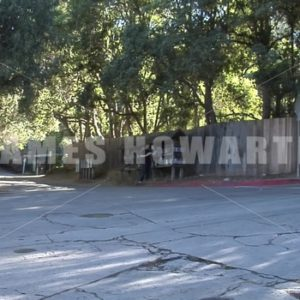 A man walks to mailboxes. - Actor Stock Footage