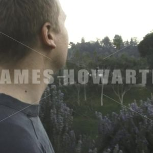 A man walks up a mountain side view. - Actor Stock Footage