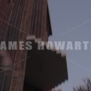 Man escapes building and runs down stairs. - Actor Stock Footage