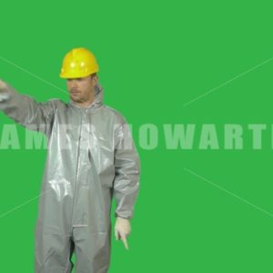 Man in hazmat and hard hat giving directions. Green screen. - Actor Stock Footage