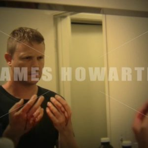 Man looks at bloody hands in mirror. - Actor Stock Footage