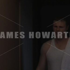 Man walking down hallway with towel angry. - Actor Stock Footage