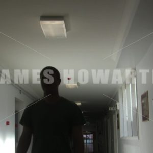 Man walks down hospital hallway. - Actor Stock Footage