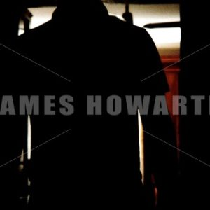 Mans Silhouette entering a doorway with bag. - Actor Stock Footage