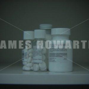 Medicine bottles placed on shelf. - Actor Stock Footage