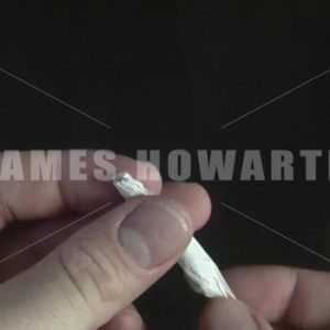 Rolling a cigarette or joint. - Actor Stock Footage