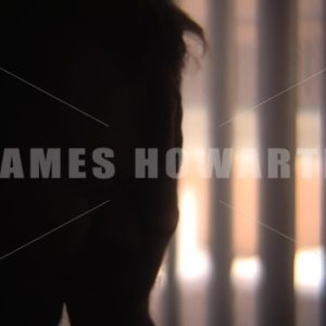 Silhouette of a man sad rubbing his head. - Actor Stock Footage